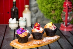 Muffins with berries and petals